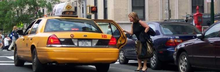 Photo by Bettina Cohen: New York City street scene showing a woman passenger entering a taxi